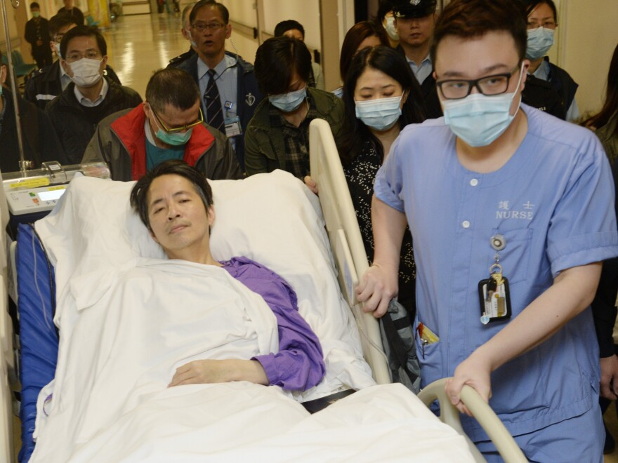 Former <em>Ming Pao</em> chief editor Kevin Lau is transferred to a private ward in a hospital Saturday in Hong Kong after three days in intensive care.