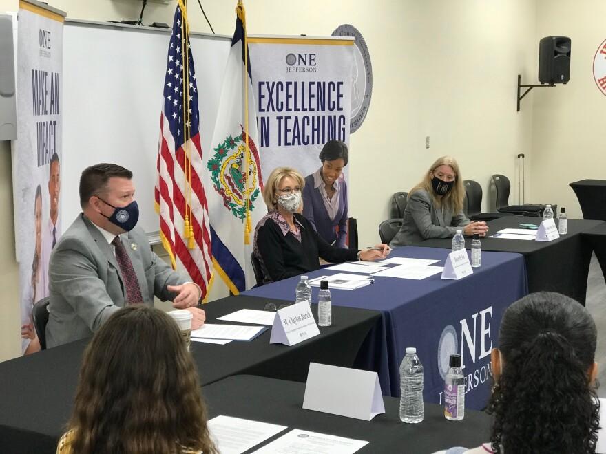 (left to right) West Virginia Superintendent of Schools Clayton Burch, U.S. Secretary of Education Betsy DeVos, and Jefferson County Schools Superintendent Bondy Shay Gibson in Kearneysville, W.Va. on Oct. 1, 2020.