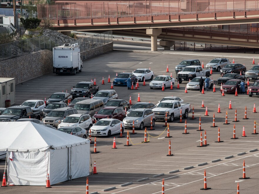 Cars wait in line at a coronavirus testing site at the University of Texas at El Paso Saturday. As El Paso reports record numbers of active coronavirus cases, the Texas attorney general sued to block local shutdown orders.