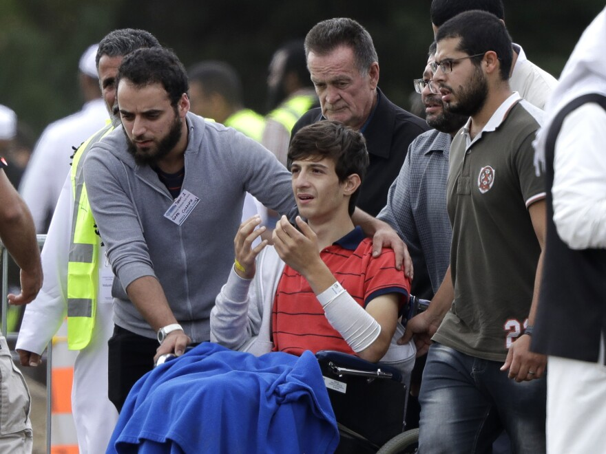 Zaed Mustafa, in a wheelchair after he was injured in the mosque shootings in Christchurch, attends the funeral of his brother, Hamza, and father, Khalid.
