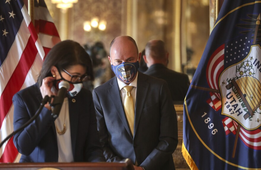 A photo of Spencer Cox and Deidre Henderson at the gov transition announcement.