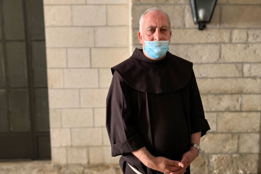 For months, Father Amjad Sabbara held a series of mini-Masses so everyone in his community could attend a socially distanced Mass at least once a month. But a second wave of infections afflicting Jerusalem's Palestinian neighborhood changed that.