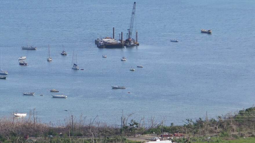 Coral Bay, on the eastern end of St. John, is home to an active sailing community. For months, the Coast Guard has been using a crane boat and barge to retrieve sunken vessels.