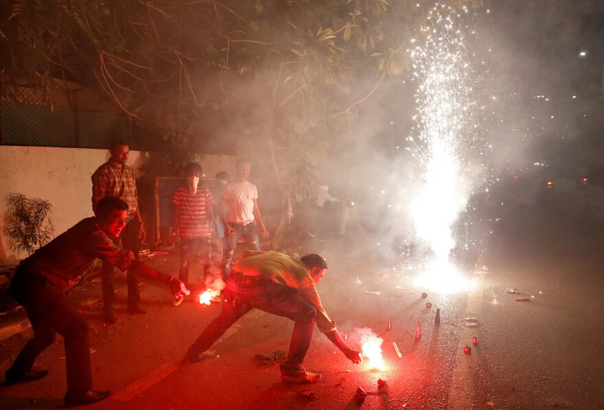 The fireworks of Diwali, the Hindu festival of lights, add smoke to the already polluted skies — and raise concern about the impact of all that pollution on coronavirus cases. This photo was taken in Ahmedabad, India, in 2019.