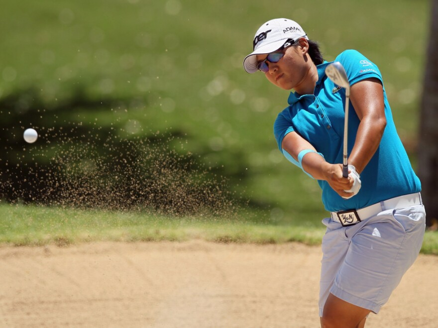 Yani Tseng of Taiwan hits a bunker shot to the ninth green during the second round of the LPGA LOTTE Championship at the Ko Olina Golf Club in Kapolei, Hawaii.