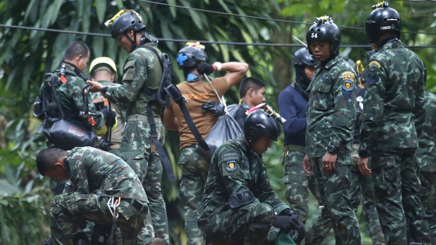 Thai rescue crews prepare Friday to enter the cave where 12 boys and their soccer coach have been trapped in Chiang Rai province, in northern Thailand. A Thai diver died while on a supply mission.