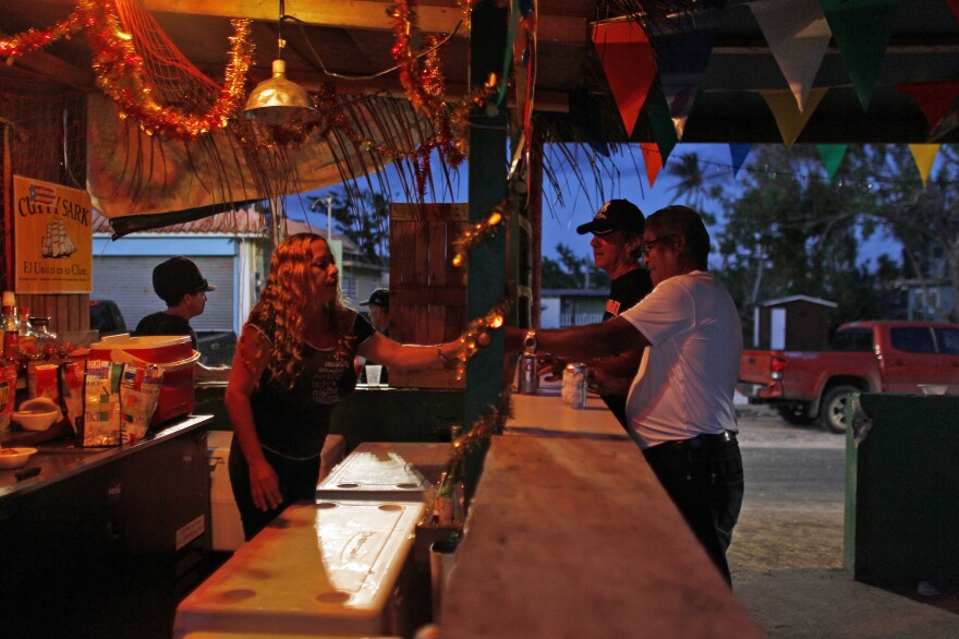 A bartender serves drinks at La Nasa bar in the Esperanza beachfront neighborhood in Vieques. The original bar was reduced to rubble by the hurricane and washed into the sea.