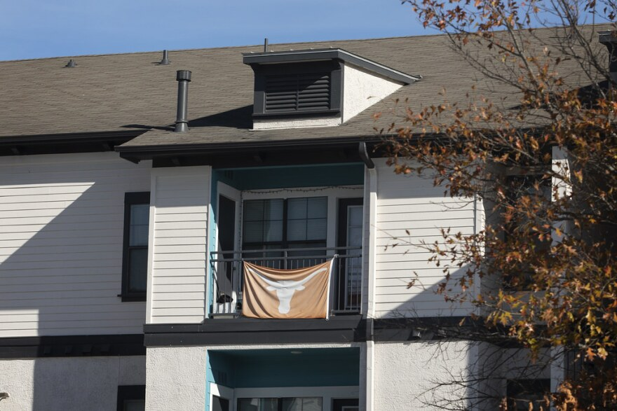 A Longhorns flag hangs on a balcony at Town Lake Apartments.