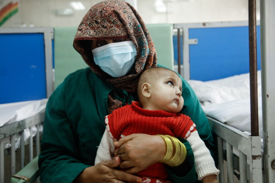 Zareena, 30, holds her fifth child, 1-year-old Fariba, at the ward for malnourished children at the Indira Gandhi Children's Hospital in Kabul.
