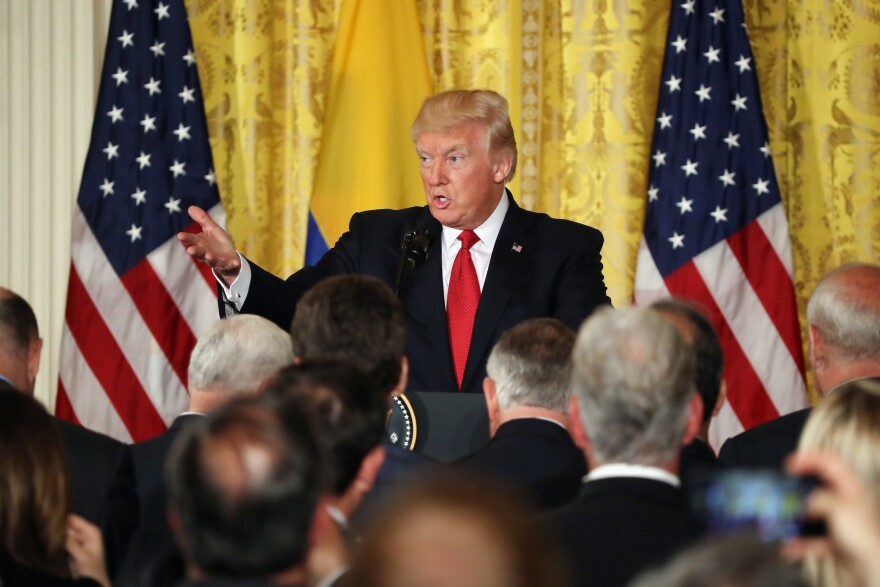 President Trump delivers remarks during a joint news conference with Colombian President Juan Manuel Santos at the White House on Thursday.