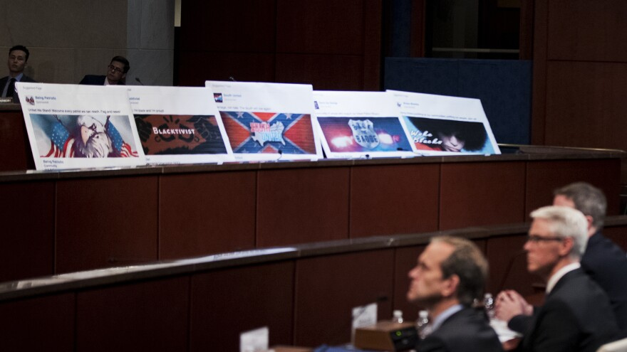 Facebook ads linked to a Russian effort to disrupt the American political process are displayed as, from left, Google's Kent Walker, Facebook's Colin Stretch and Twitter's Sean Edgett, testify during a House Intelligence Committee hearing on Wednesday, Nov. 1, 2017.