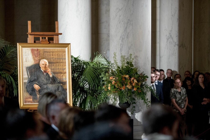 A portrait of Stevens is displayed during a private ceremony in the Great Hall.