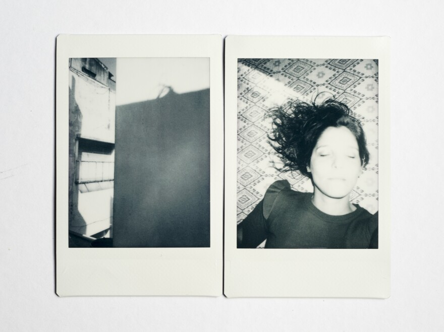 (Left) Alonso lives in a small but comfortable apartment. She has everything she needs. View from the living room window, where she sees shadows from one building to the next. (Right) Self-portrait in her room.