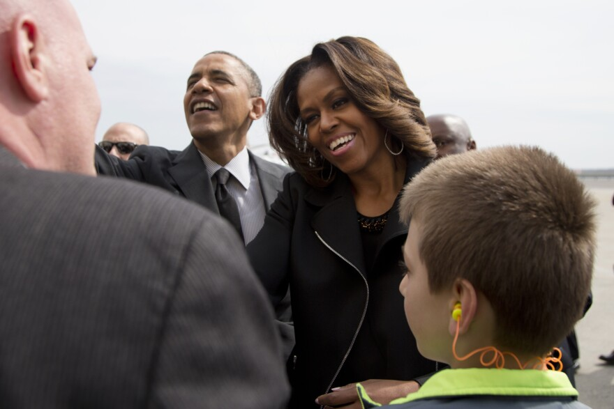 President Obama and first lady Michelle Obama arrive at John F. Kennedy International Airport in New York on Friday.