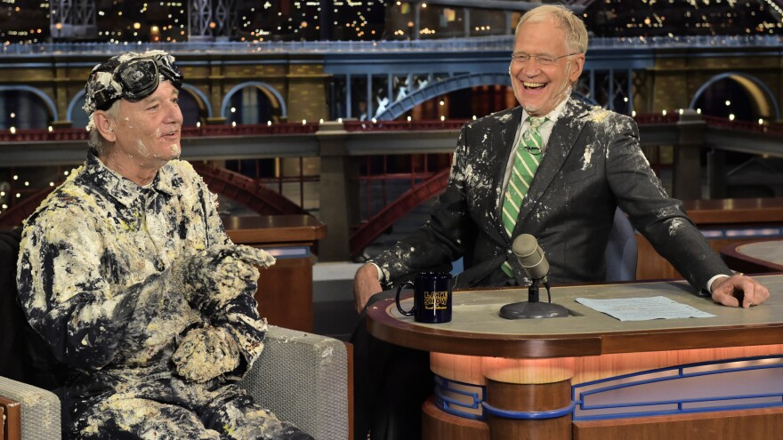 Bill Murray emerged from a cake to give David Letterman a goodbye embrace during Tuesday's taping of <em>The Late Show. </em>Letterman is ending his run as the show's host Wednesday.