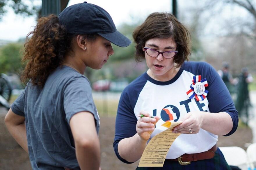 Julie Gilberg helps with voter registration