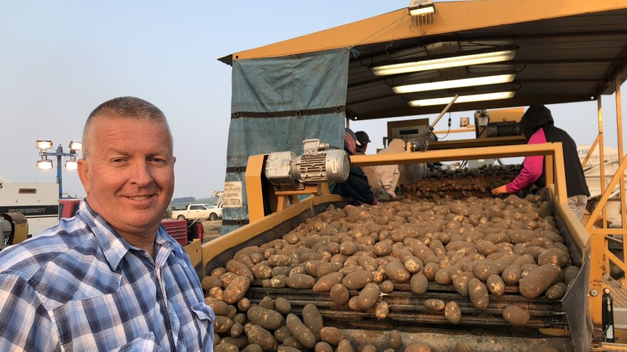 Mike Pink owns about 1,600 acres of potatoes. He says he can't afford a week of smoky conditions that might stall his crops.