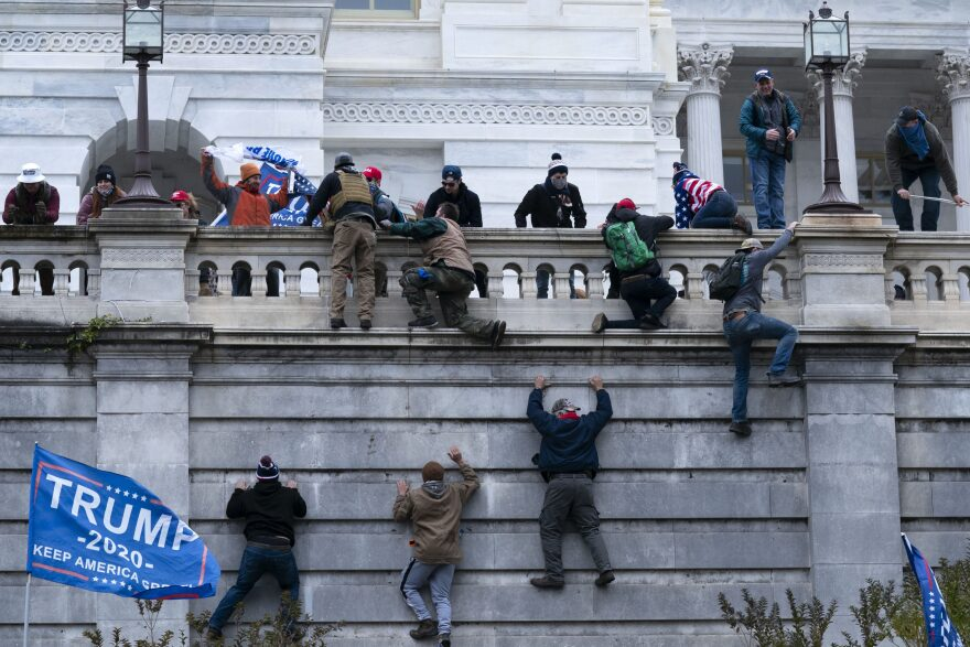 Supporters of President Trump climb the West wall of the U.S. Capitol on Jan. 6. (Jose Luis Magana/AP)