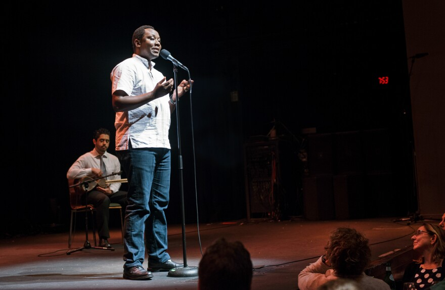Dr. Thumbi Mwangi, an infectious disease epidemiologist from Kenya, speaks at the Moth Slam event at Howard Theatre in Washington, D.C. on Nov. 29, 2016.
