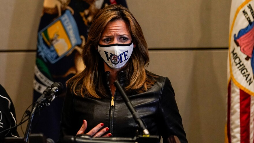 Michigan Secretary of State Jocelyn Benson says protesters were trying to intimidate her by visiting her home Saturday night. She's seen here discussing the Nov. 3 election during a news conference last month.