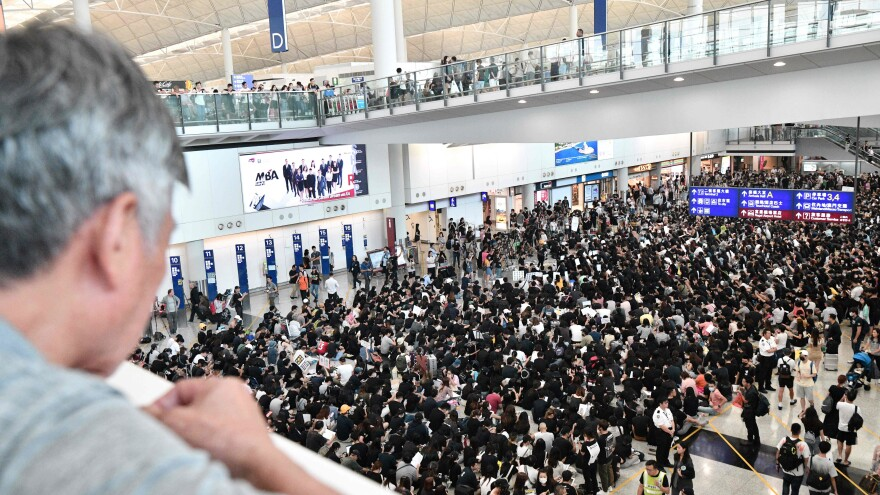 Hundreds of pro-democracy protesters rally at Hong Kong's international airport on Friday.