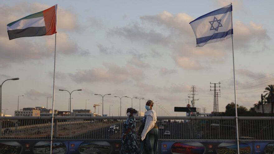 The flags of the United Arab Emirates and Israel are raised on the Peace Bridge in Netanya, Israel. The UAE flag was displayed to celebrate last week's announcement that the two countries have agreed to establish diplomatic relations.