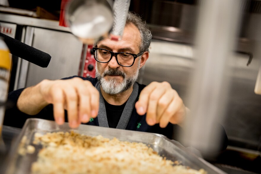 """Chef Massimo Bottura creates a meal from Thanksgiving leftovers in NPR's kitchen. """"The leftover is a big problem if you don't have a vision, if you don't have the knowledge of what you can do,"""" he says. Above, he checks the breadcrumbs to make sure they're dry and fine enough to turn into a pasta called passatelli."""