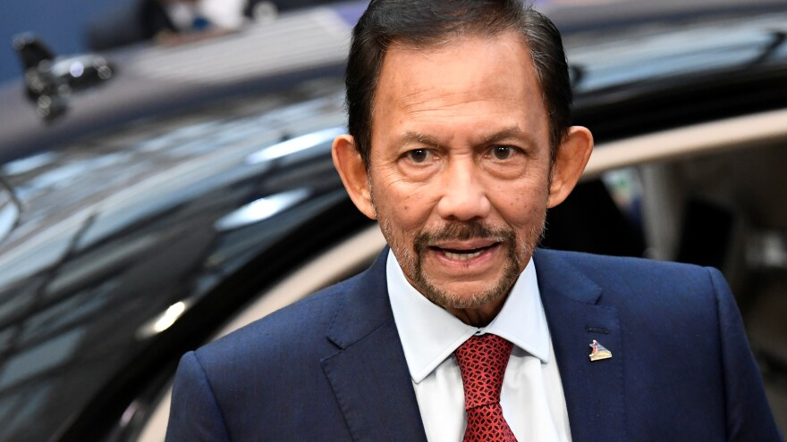 Sultan of Brunei Hassanal Bolkiah, seen arriving for meetings in Brussels last fall, now says his country will not impose the death penalty in cases involving gay sex and adultery.