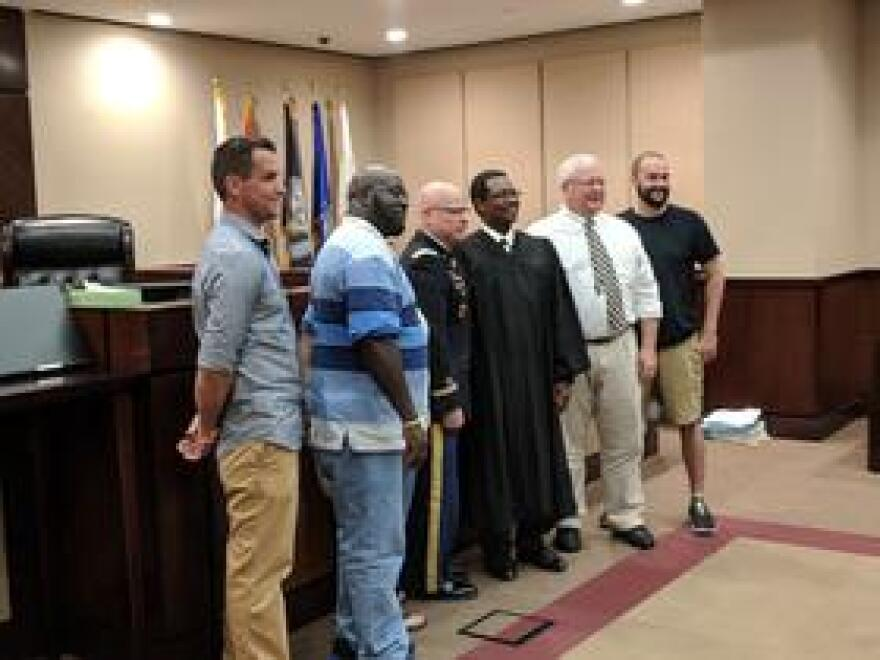 Graduates of the Leon Veterans' Court pose for a post-ceremony photo on Aug. 20 with Keynote Speaker Col. George Brown, Jr. and Judge Augustus Aikens.