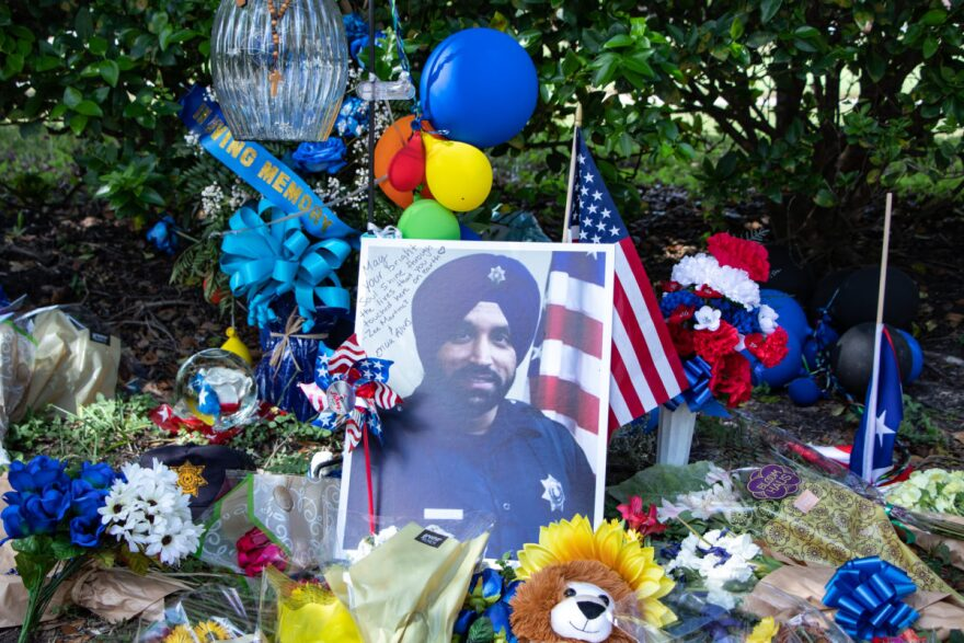 A roadside memorial continues to grow for Harris County Sheriff's Deputy Sandeep Dhaliwal.