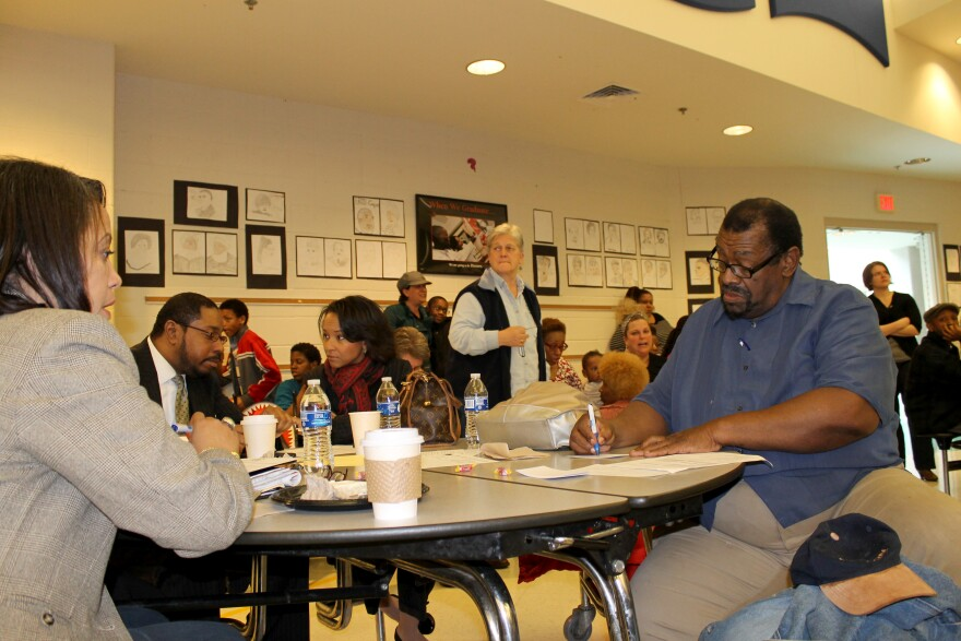 Normandy parents and community members discuss an update on Normandy Schools Saturday March, 14, 2015.