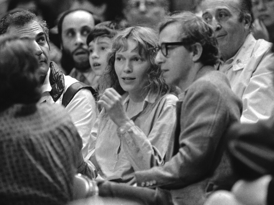 Mia Farrow and Woody Allen watch a basketball game in 1983. Dylan Farrow's statement alleging that Allen abused her was published online by a <em>New York Times</em> columnist.
