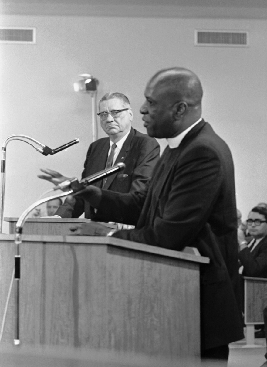 Miami police Chief Walter Headley, left, watches as the Rev. Theodore Gibson tells the Miami City Commission he believed Headley had used overly strong language in announcing his war on crime in December 1967.