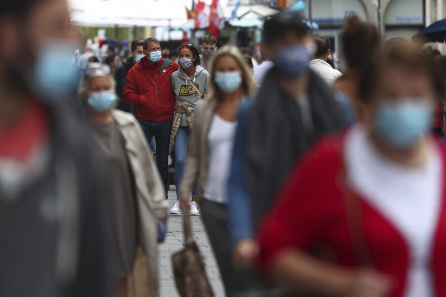 People wear face masks as they walk through the city center in Munich, Germany, Thursday, Sept. 24, 2020. (Matthias Schrader/AP)