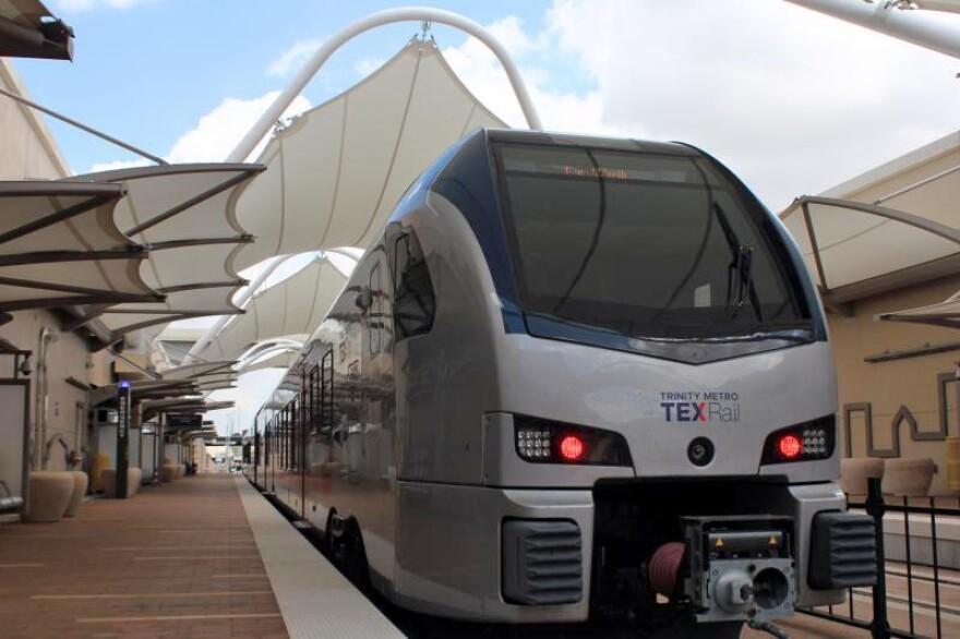 A TEXRail train waits at DFW International Airport Terminal B.