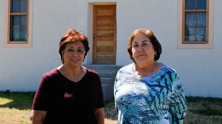 "Jessi Silva and Maggie Marquez on the grounds of the Blackwell School in Marfa, Texas. The school closed in 1965 and some of it was demolished. Both women returned to the grounds in 2007 with a group of alumni to hold a symbolic ceremony to unearth ""Mr. Spanish."""