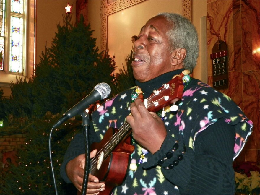 Mr. Woodard with his ukulele and St. Stanislaus