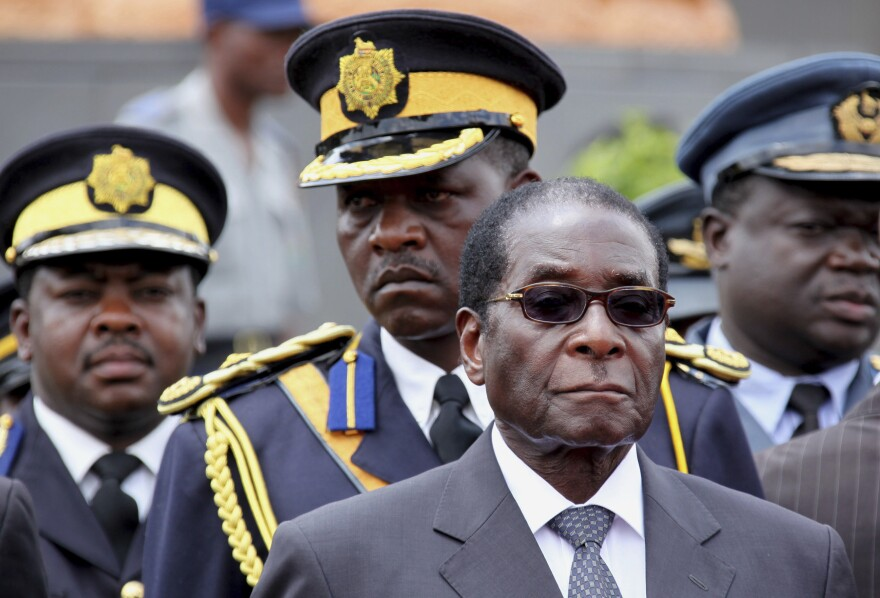 In this Oct. 31, 2009, photo, Zimbabwe's then-President Robert Mugabe attended the burial of a prominent member of his party in Harare.