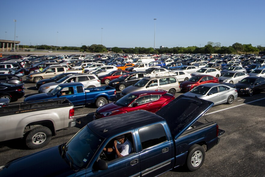 Cars line up to receive food boxes during a Central Texas Food Bank emergency food relief distribution at Toney Burger Stadium on April 30.