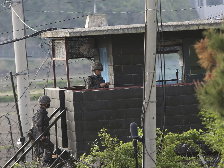 North and South Korean troops exchanged fire along their tense border on Sunday, the South's military said, blaming North Korean soldiers for targeting a guard post.