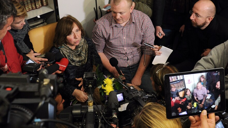Writer Svetlana Alexievich answers questions during a press conference in Minsk, Belarus, on Oct. 8, following the announcement of her Nobel Prize. Alexievich writes about hard truths, making Russian authorities uncomfortable. She says she wants her country to be better — instead of comfortable with where it is.