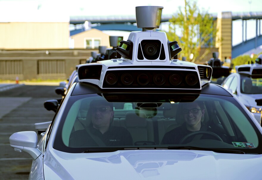 A pair of Uber technicians will ride inside each of the new self-driving cars offering rides to regular Uber users during an indefinite testing phase.