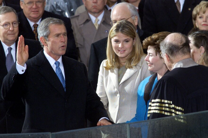 George W. Bush takes the oath of office from Chief Justice William Rehnquist to become the 43rd president on Jan. 20, 2001, in Washington. Wife Laura Bush holds the Bible beside daughter Jenna.