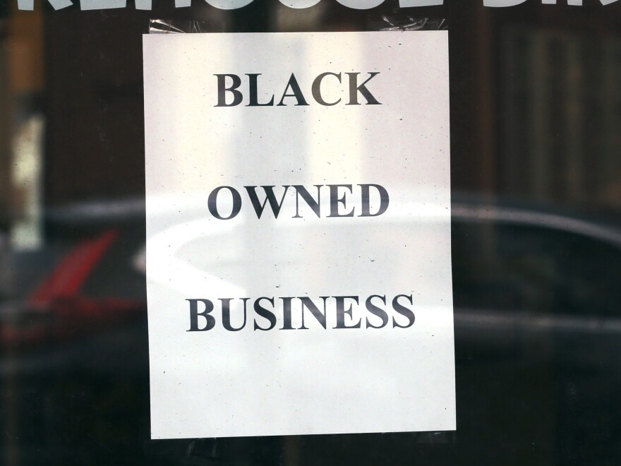 A store in Boston displays a sign noting its Black ownership on June 24, 2020. Black-owned businesses struggled to get coronavirus emergency loans last year, until community lenders stepped in to help.