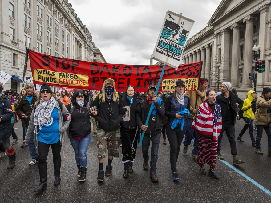 Protesters walk to the White House in Washington, D.C., during a demonstration against the Dakota Access Pipeline in March 2017.