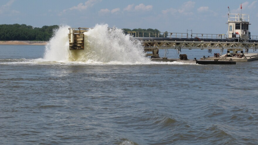 Water gets churned up at the end of a dredging pipeline connected to a U.S. Army Corps of Engineers dredge on the Mississippi River near Memphis, Tenn., on Monday. The river has seen water levels from Illinois to Louisiana plummet because of drought conditions in the past three months. When there's less flow coming downstream, saltwater from the Gulf wedges its way in.