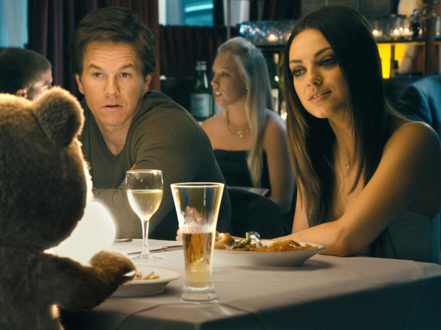 When Johnny's girlfriend, Lori (Mila Kunis), tires of Ted's constant presence around the house, Ted gets a job — which is when the comedy catches fire.