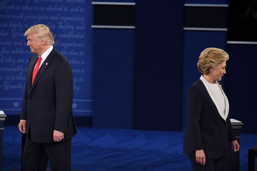 Donald Trump and Hillary Clinton arrive for the second presidential debate at Washington University in St. Louis, Mo., on Oct. 9. A new report says brand loyalty among the two major presidential candidates is sorely lacking.