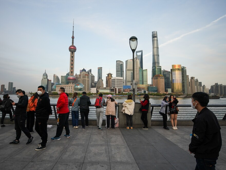 People gather along the waterfront of the Bund on Tuesday in Shanghai.
