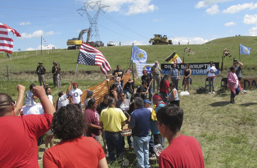 In August 2016, demonstrators rally near the Standing Rock Sioux Reservation. That same month, a subsidiary of the company building the pipeline, accused protesters of halting construction activities.
